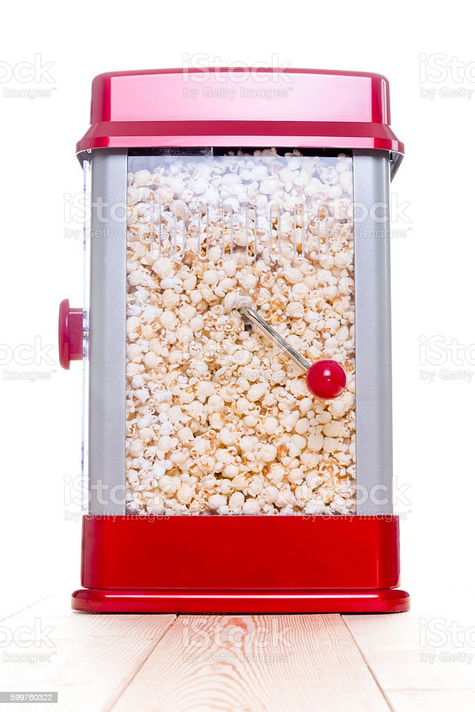 Cute red popcorn popping device stock photo