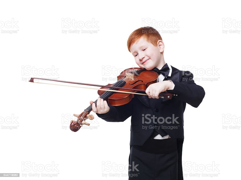 Cute redhead child boy plays violin isolated at white background stock photo