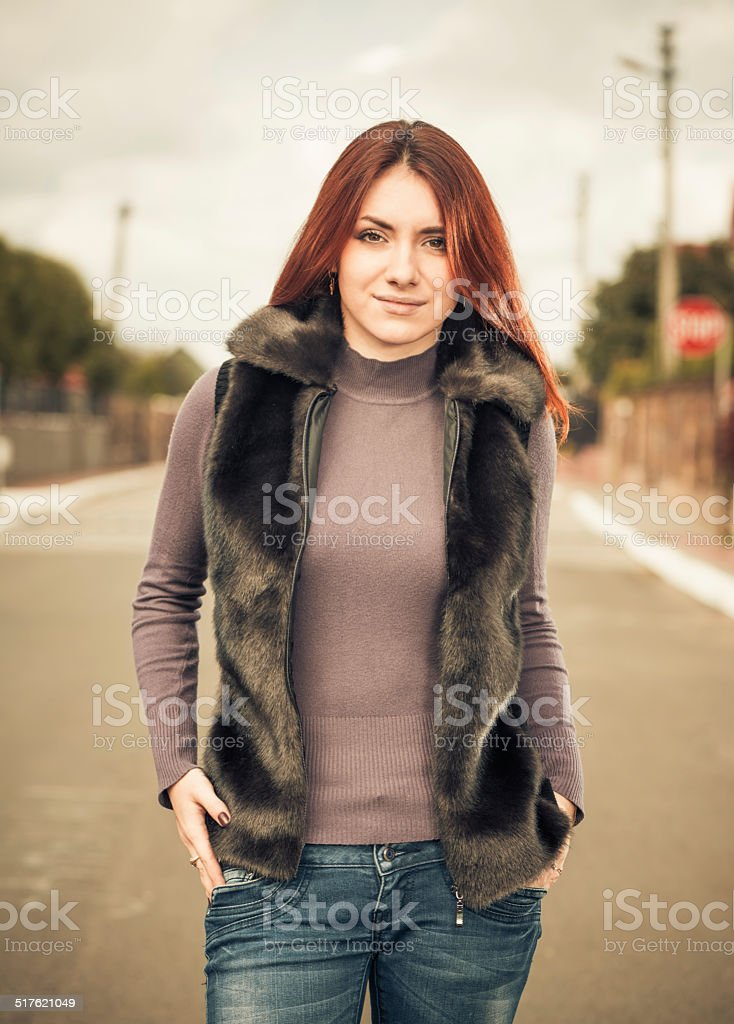 cute redhead woman at uptown street stock photo