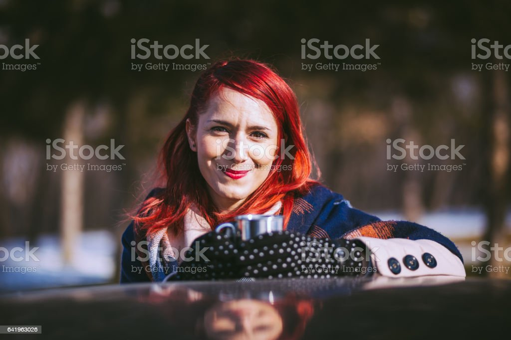 Cute Redheaded Driver Girl In Winter Time stock photo