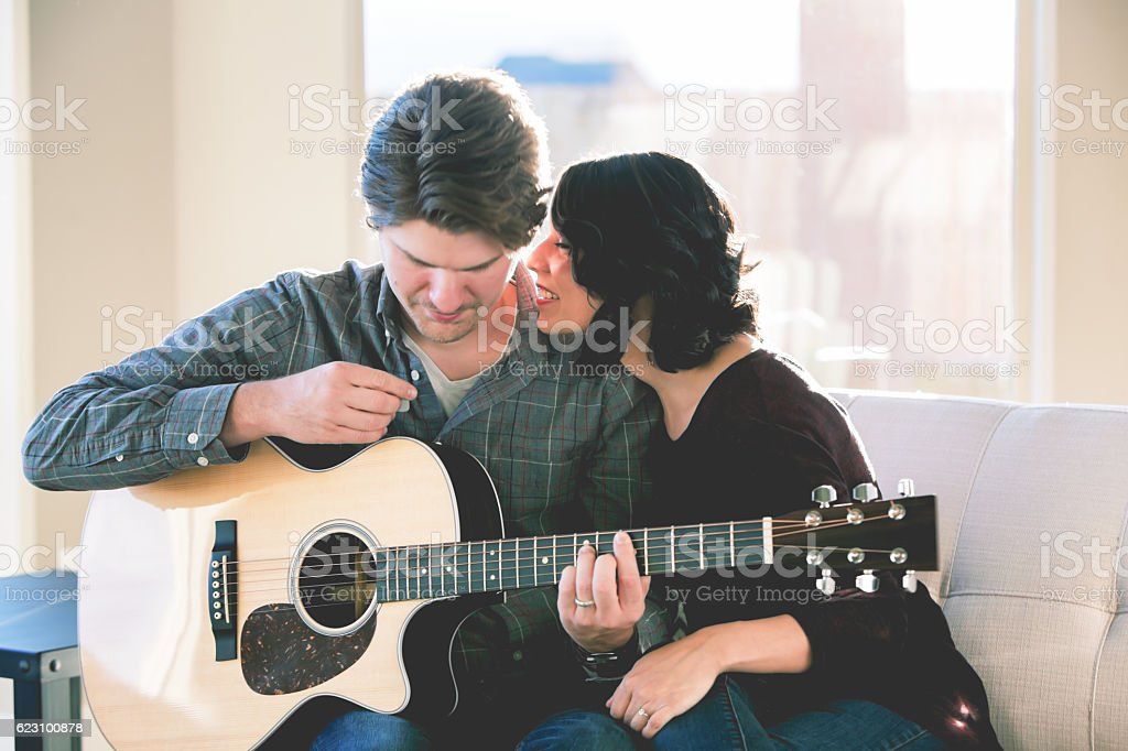 Cute Romantic Mixed Race Couple with Guitar stock photo