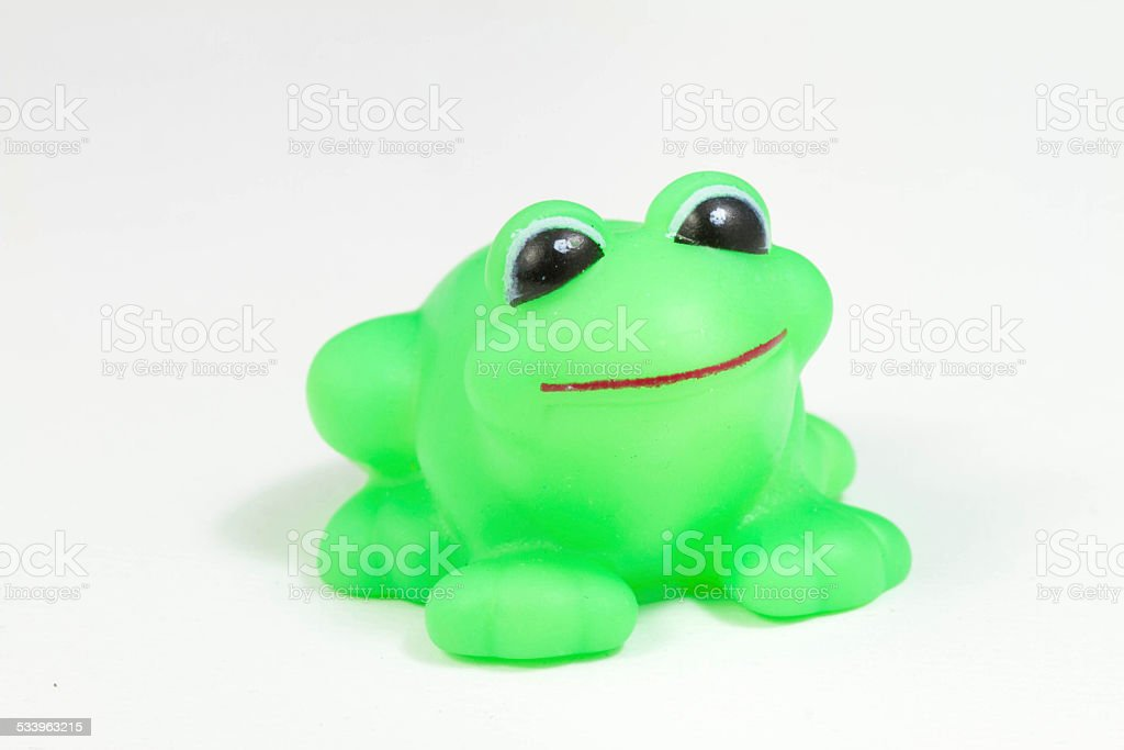 Cute rubber frog isolated over white background royalty-free stock photo