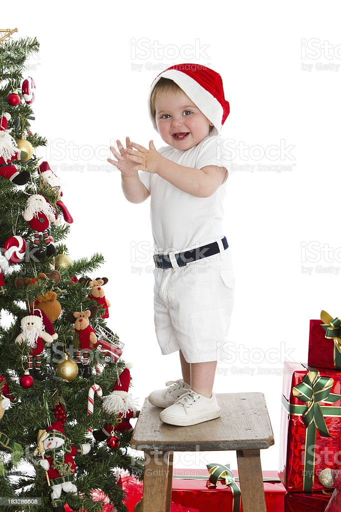 Cute Santa baby standing beside Xmas Tree royalty-free stock photo
