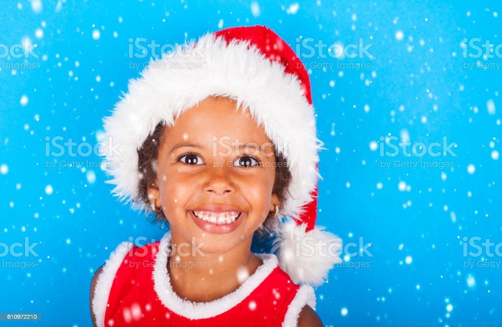 Cute santa helper with huge smile stock photo