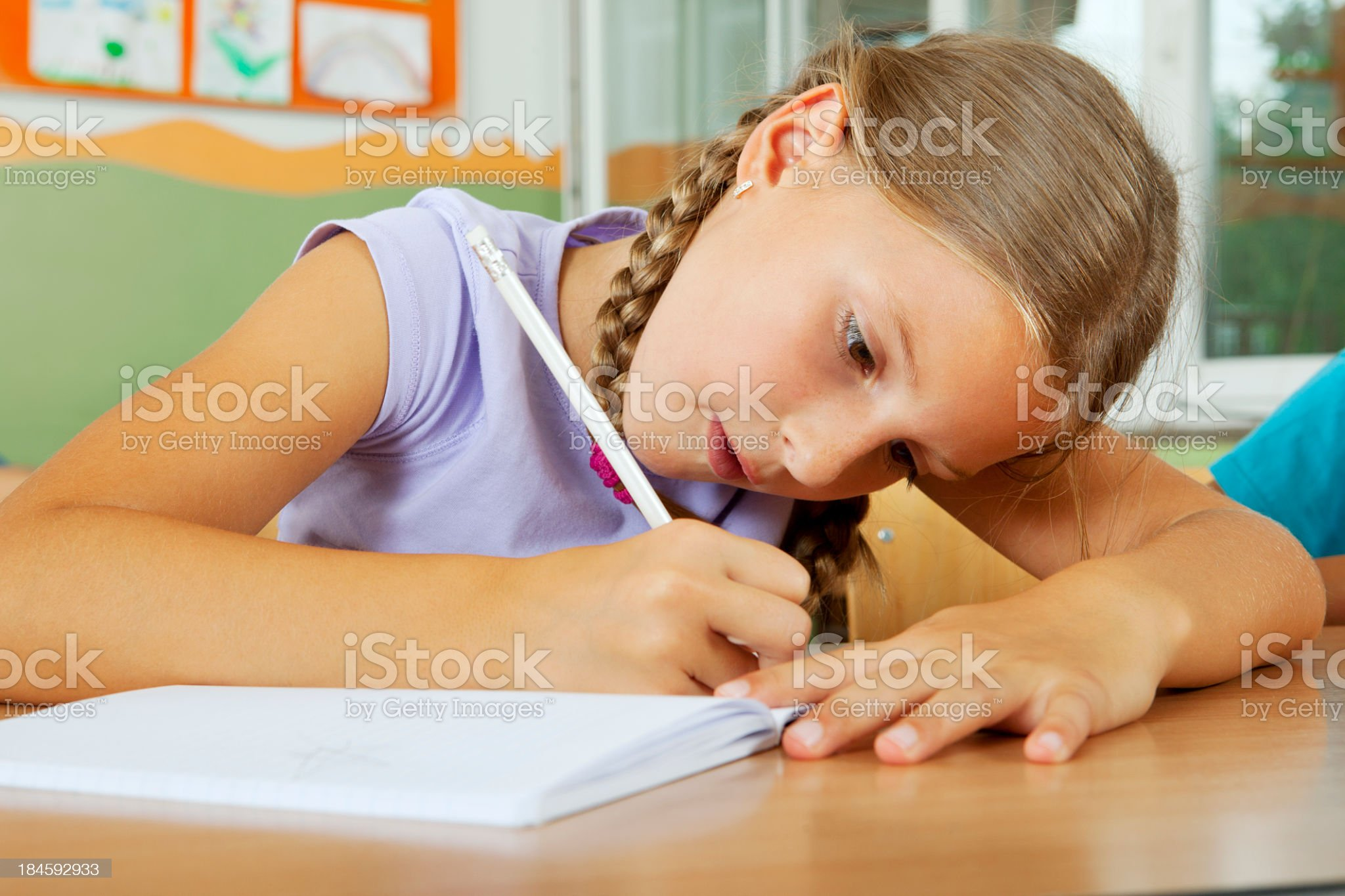 Cute School Girl in the classroom royalty-free stock photo