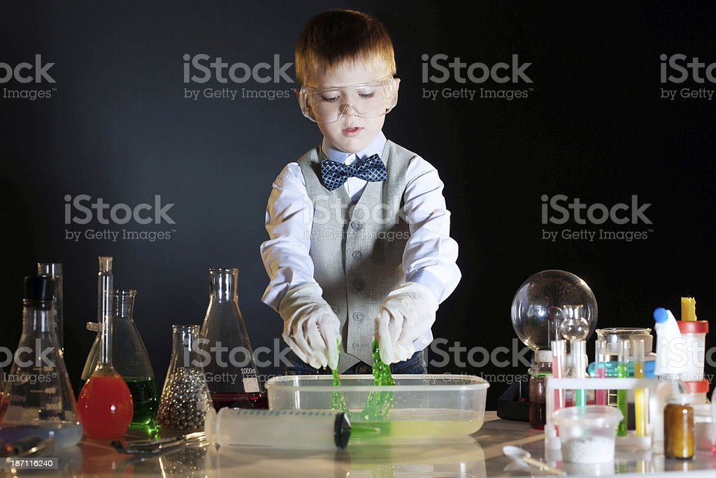 Cute schoolboy watching reaction of reagents royalty-free stock photo