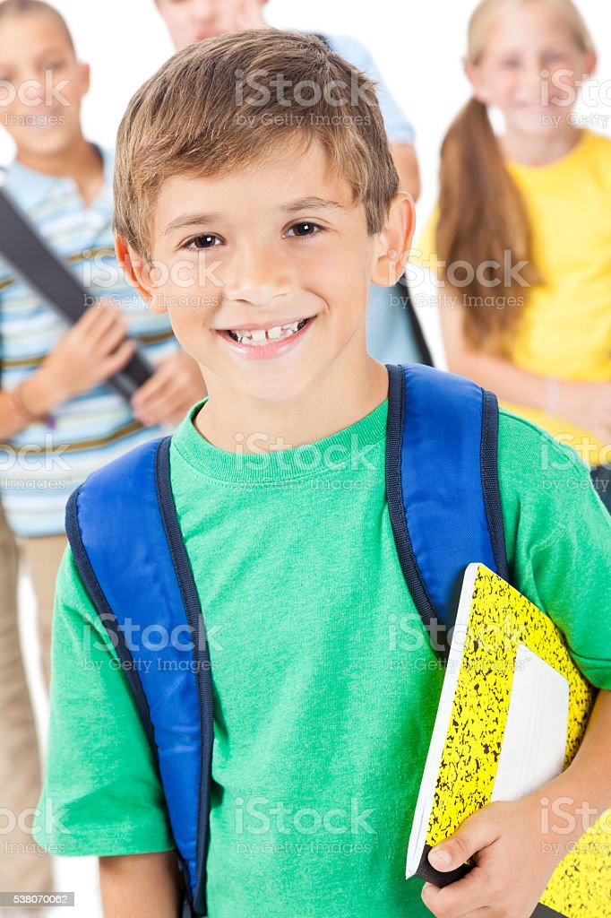 Cute schoolboy with backpack and friends stock photo