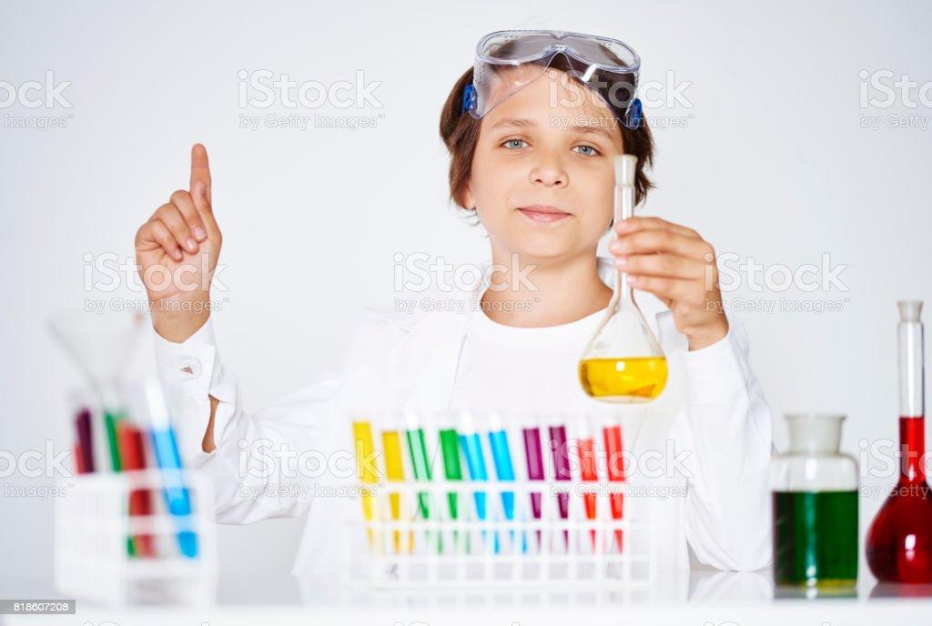 Cute scientist has great idea stock photo