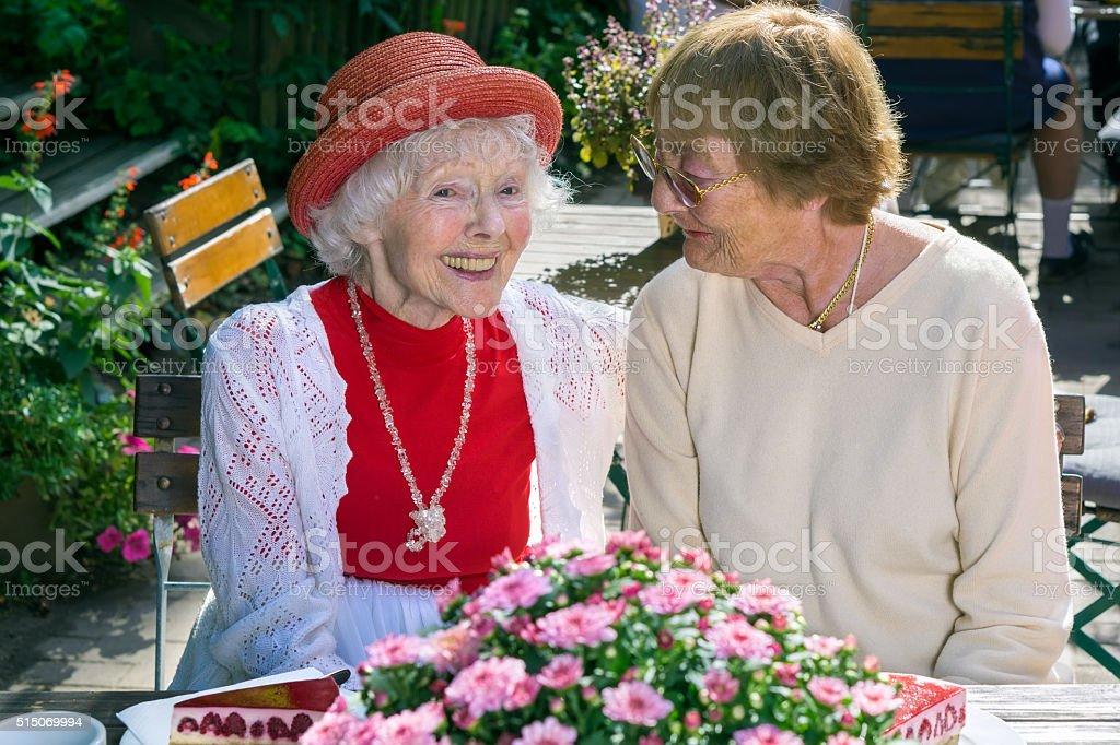 Cute senior ladies smiling and talking. stock photo