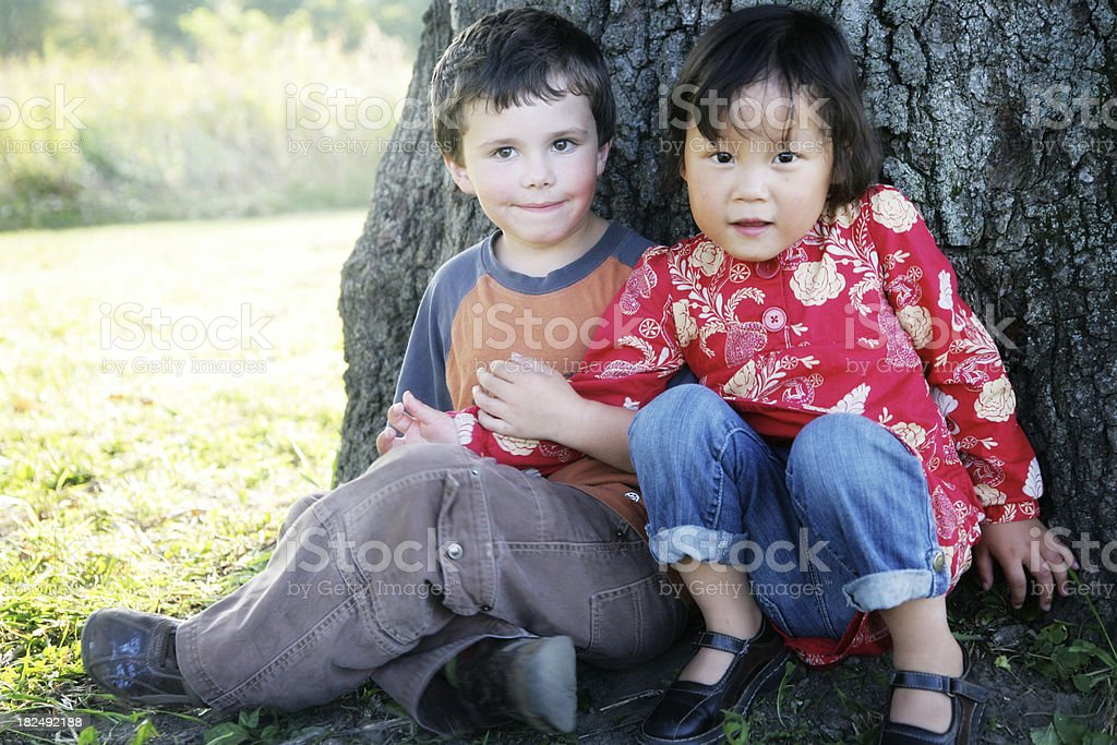 Cute Siblings Looking at Camera stock photo