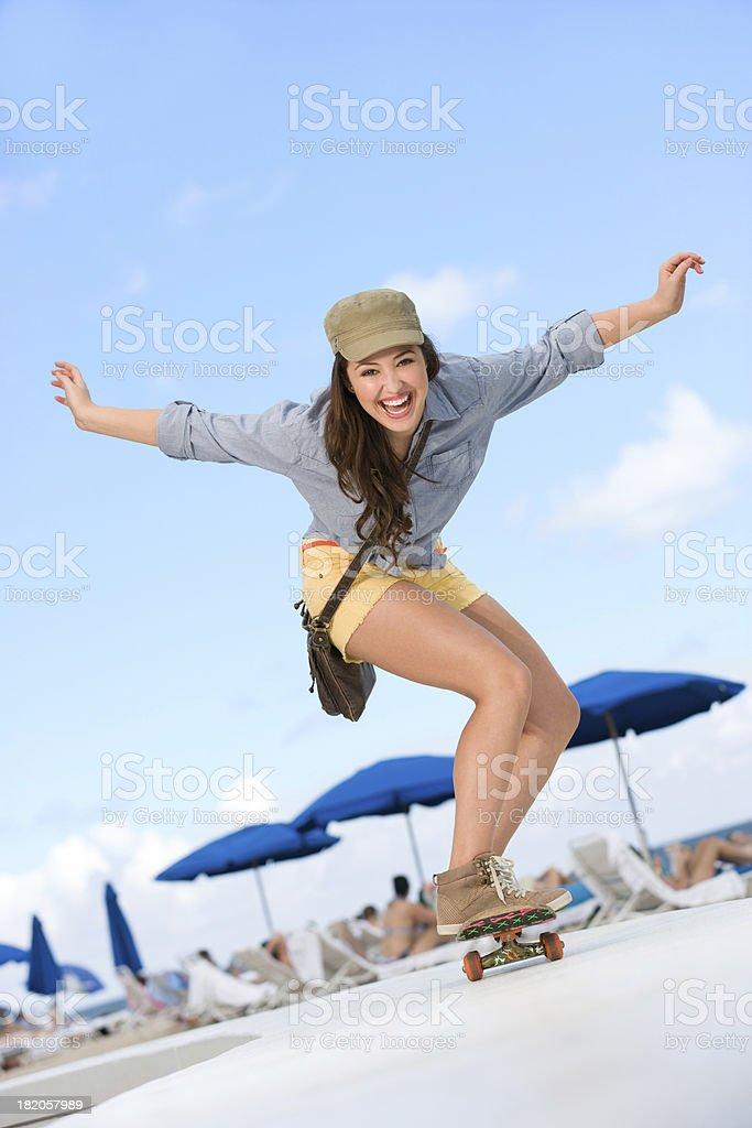 Cute Skater girl skateboarding royalty-free stock photo