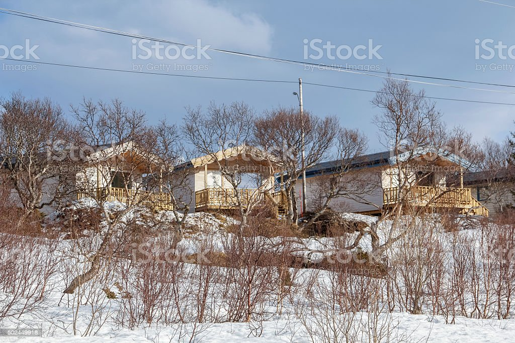 Cute small white wooden cottages stock photo