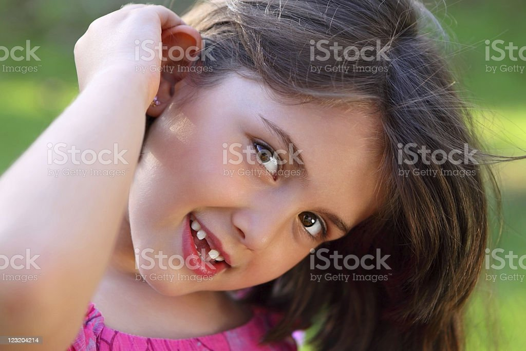 Cute Smiley Little Girl Looking royalty-free stock photo