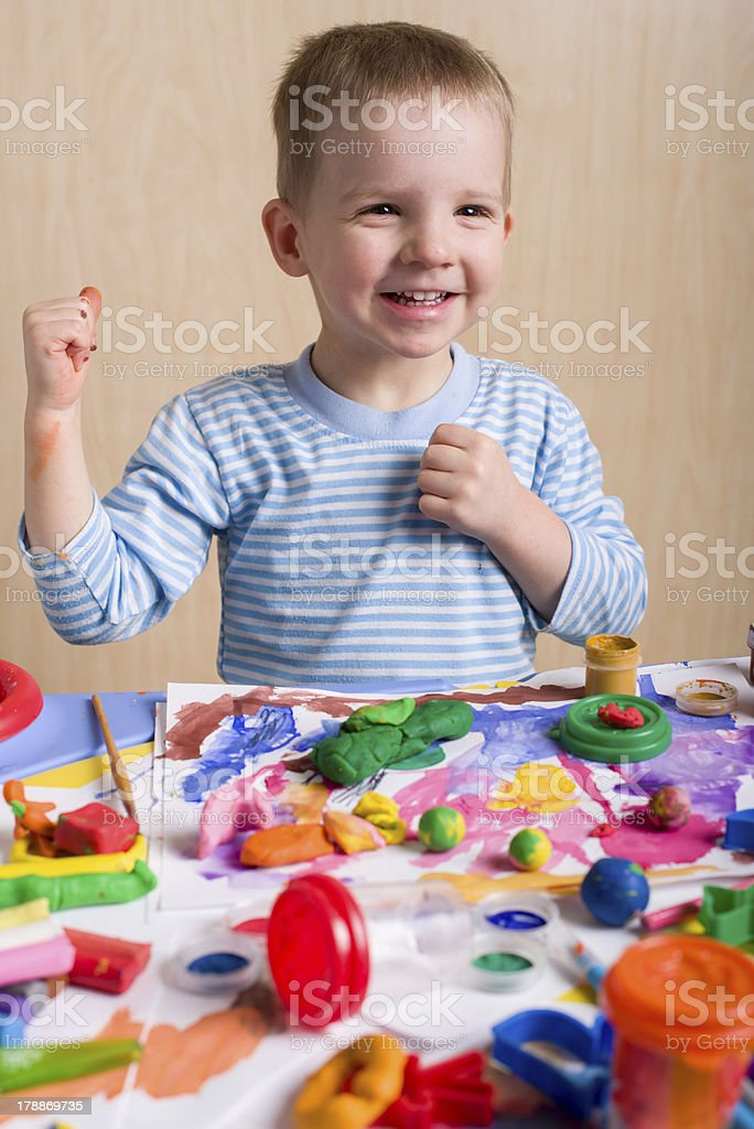 Cute smiling boy painting royalty-free stock photo