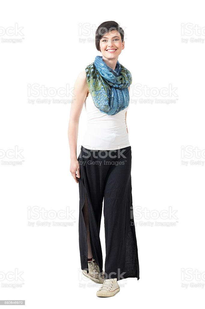 Cute smiling fashion woman walking forward and looking at camera stock photo