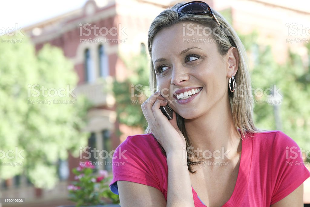 Cute Smiling Female in the City on her Cellular Phone royalty-free stock photo