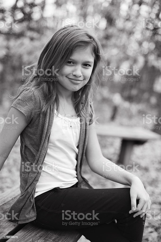 Cute Smiling Girl with Dimples Sitting Outside royalty-free stock photo