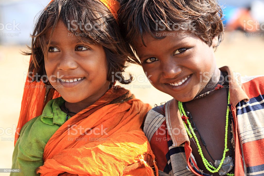 cute smiling indian little girl and boy stock photo