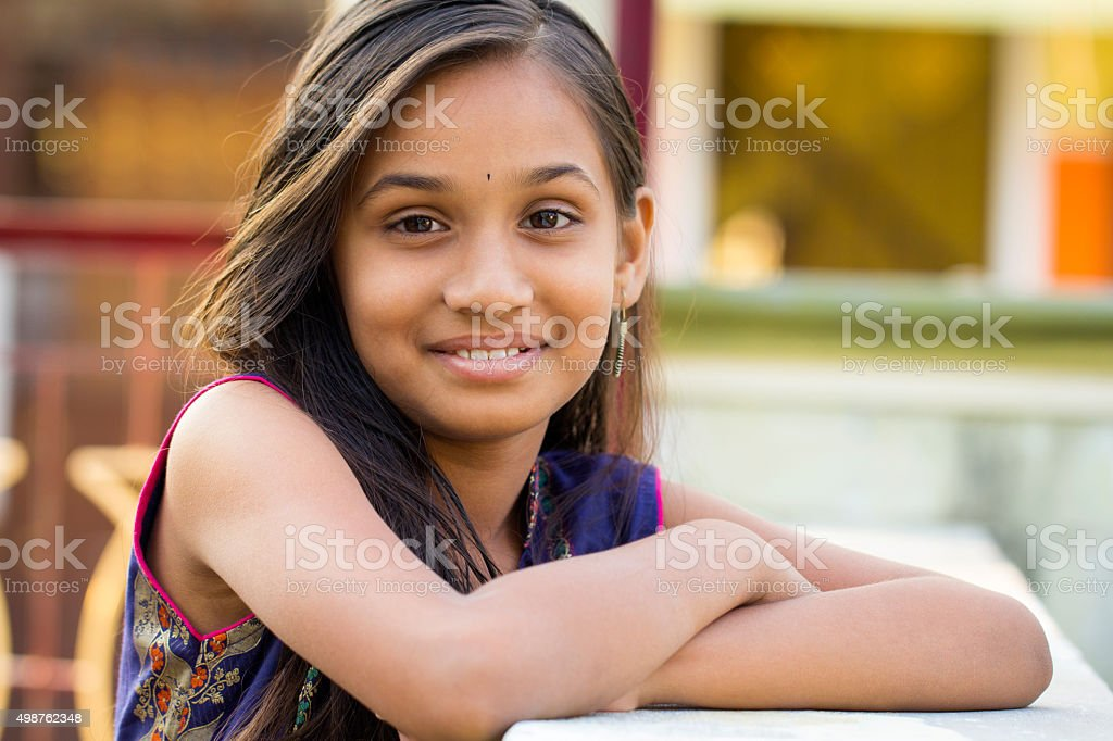Cute smiling Indian teen girl stock photo