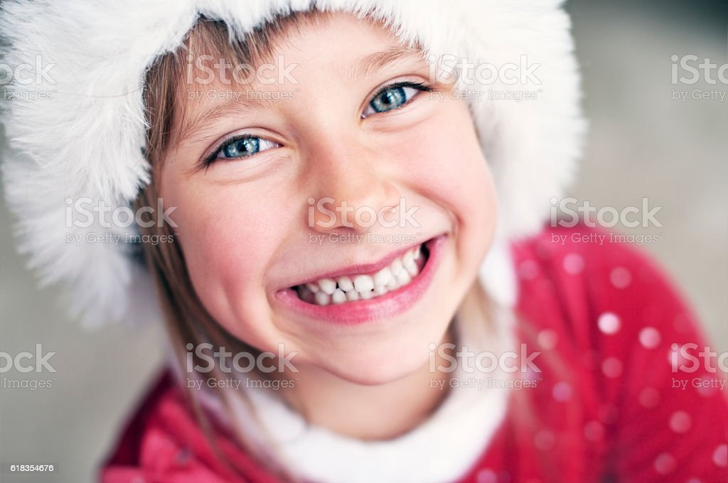 Cute smiling little girl dressed as santa helper stock photo