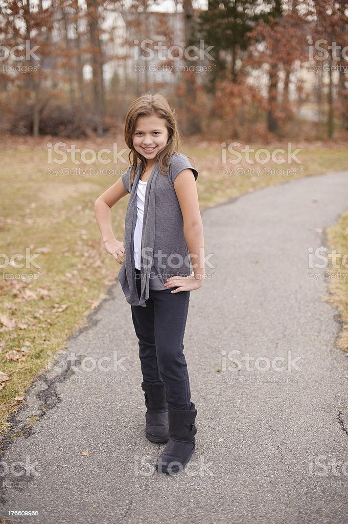 Cute Spanish Girl Standing Outside With Hands on Hips royalty-free stock photo