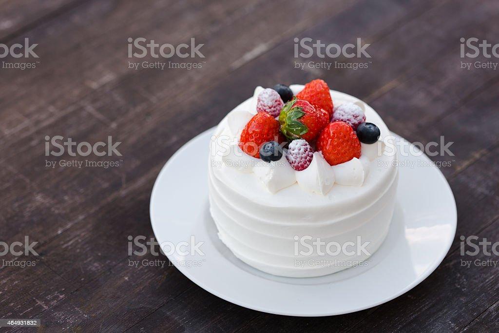 A cute strawberry shortcake on a white plate stock photo