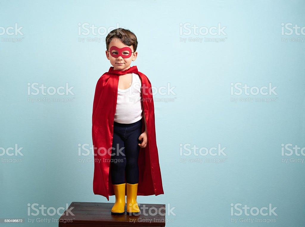 Cute superhero kid stock photo