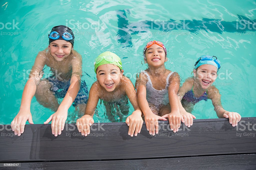 Cute swimming class in the pool stock photo
