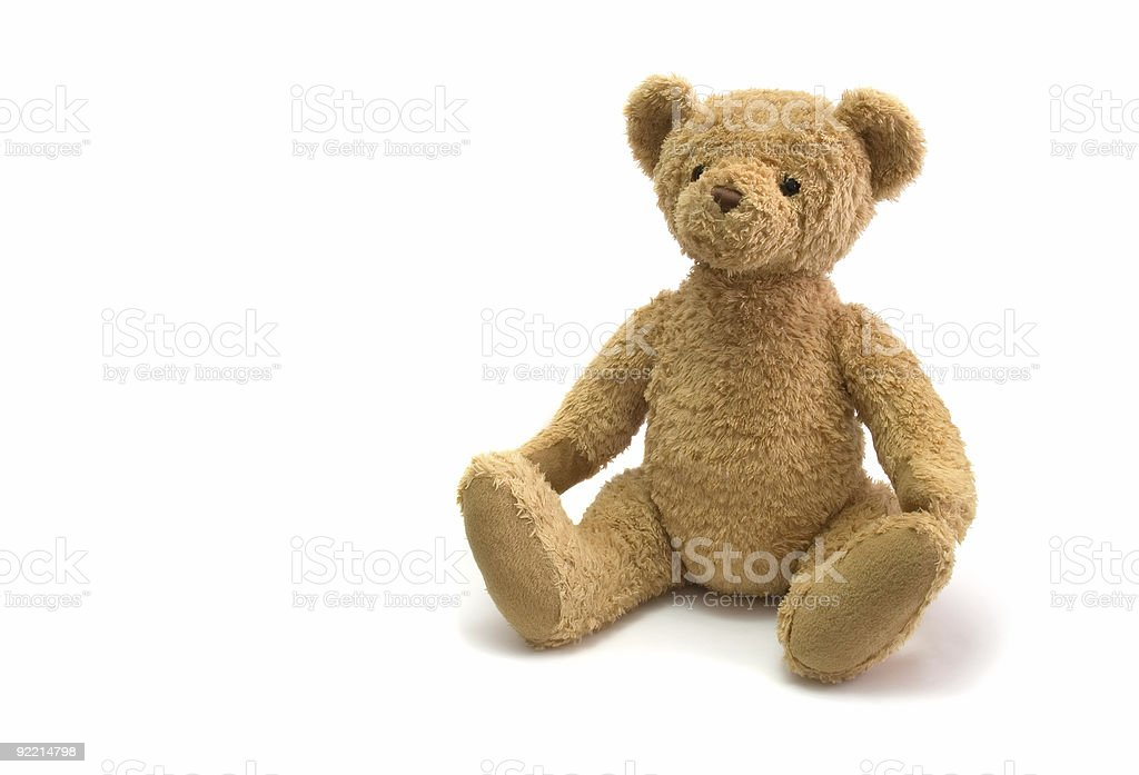 Cute tan teddy bear on a white background royalty-free stock photo