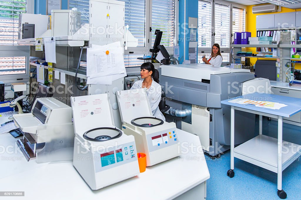 Cute Technicians in laboratory of blood bank working stock photo