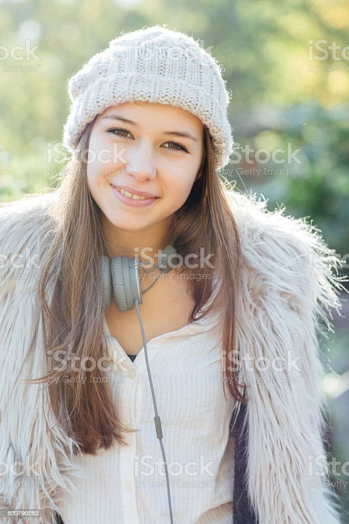 cute teenage girl portrait on nature background stock photo