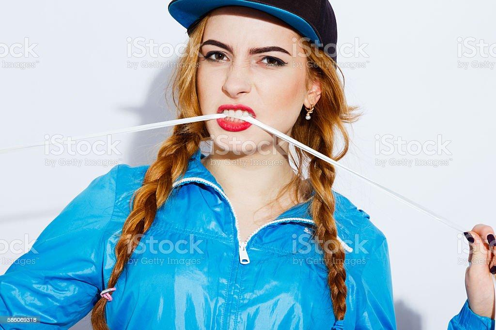 Cute teenage girl posing on white background stock photo