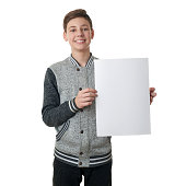 Cute teenager boy in gray sweater over white isolated background