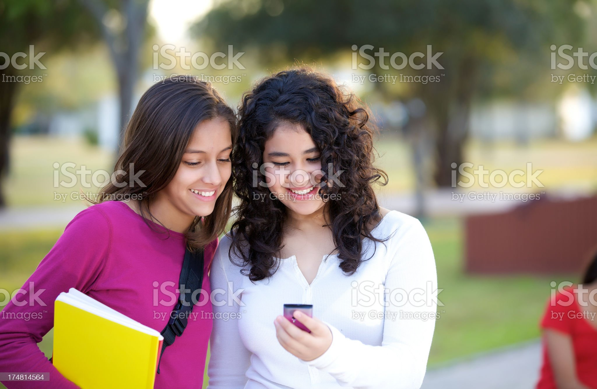 Cute teenagers using cellphone royalty-free stock photo