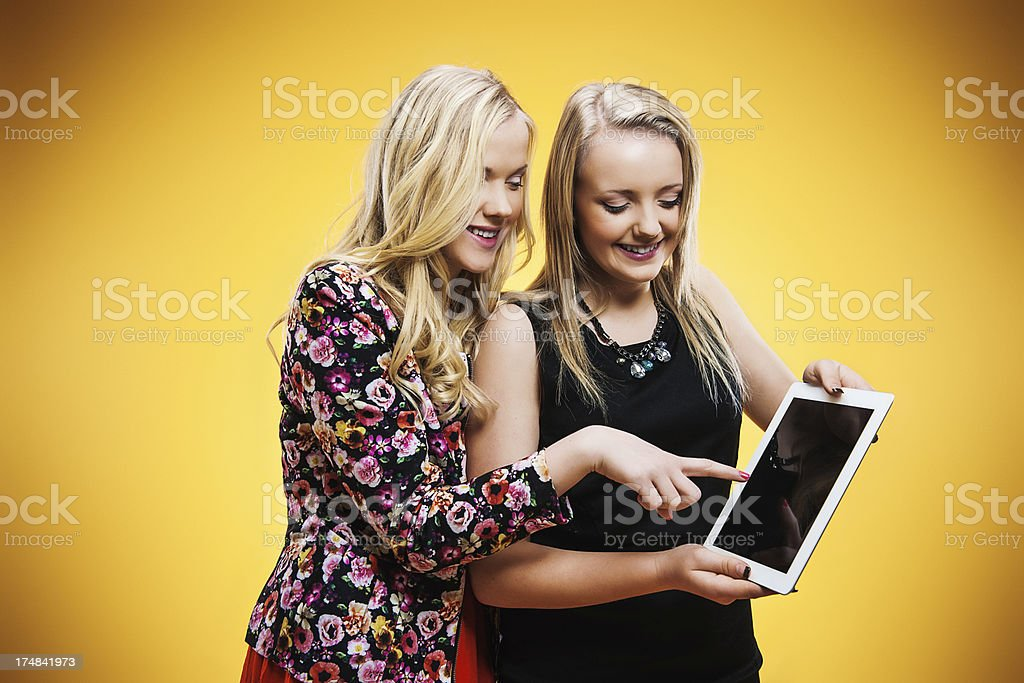 Cute teenagers with digital tablet royalty-free stock photo