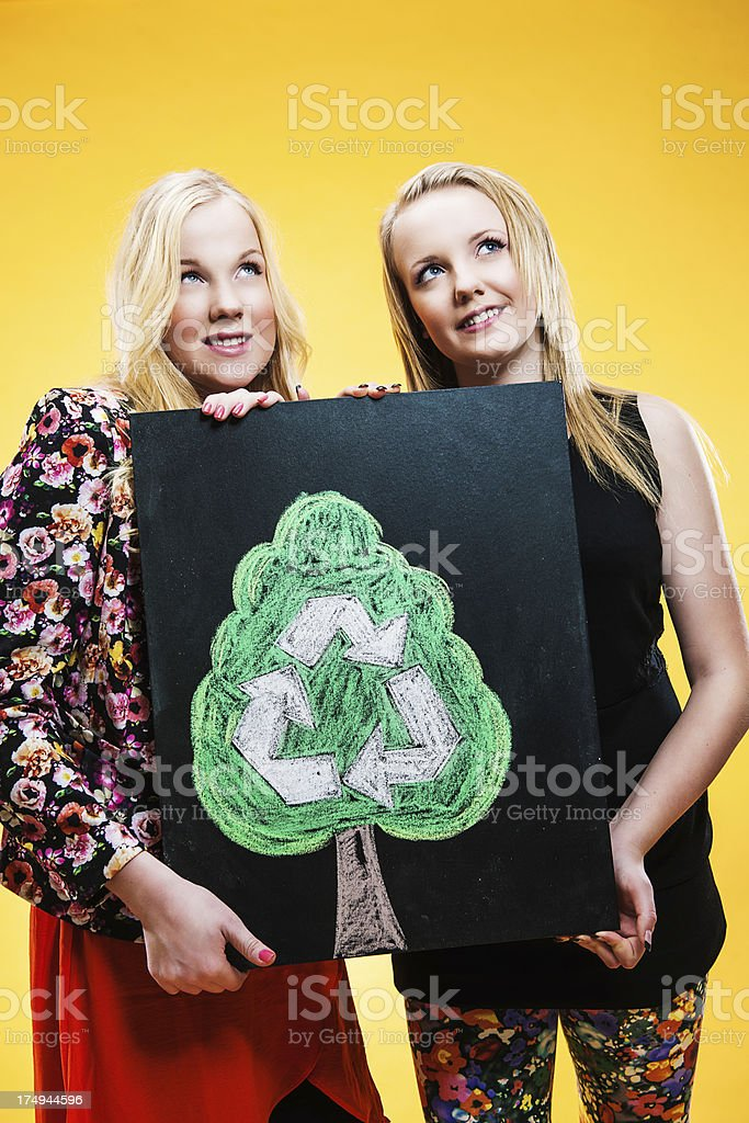 Cute teenagers with recycle sign royalty-free stock photo