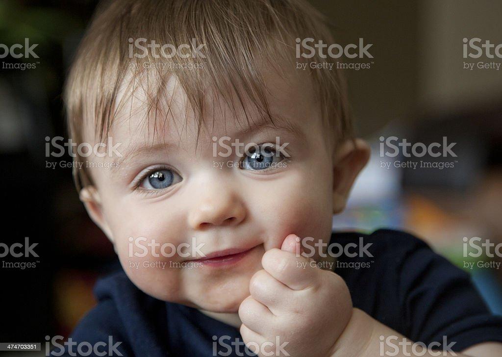 Cute teething Baby Boy stock photo