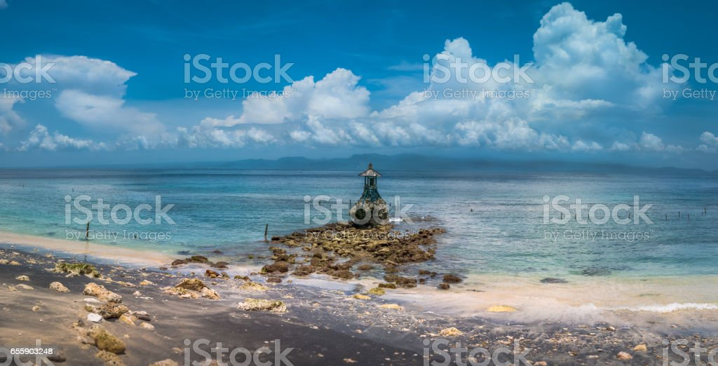 Cute Temple on the Shore by the Sea on Nusa Penida with Dramatic Clouds above Bali, Indonesia stock photo