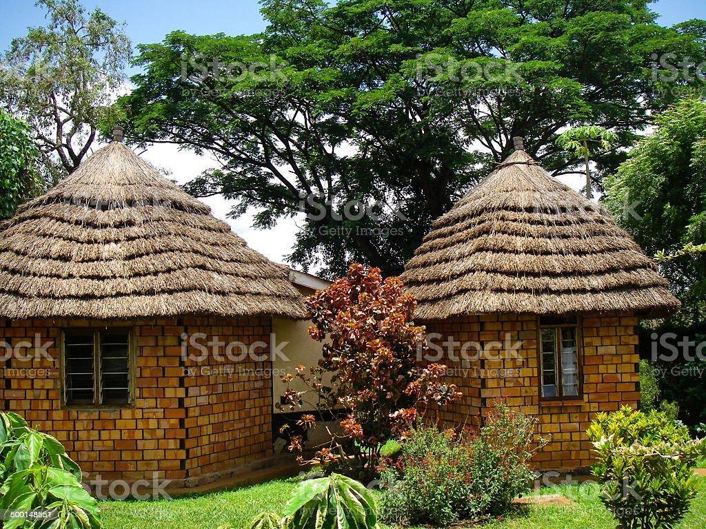 Cute Thatch-roofed Houses and Gardens Masindi Uganda stock photo