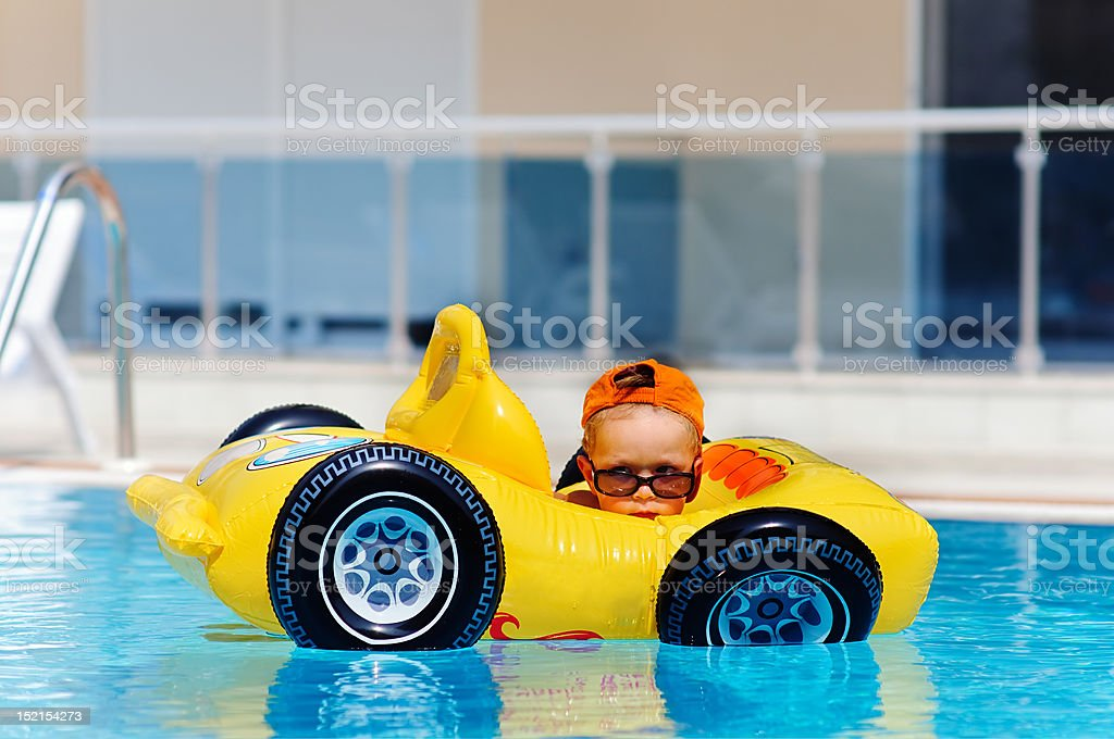 cute toddler boy have a fun in pool outdoor stock photo