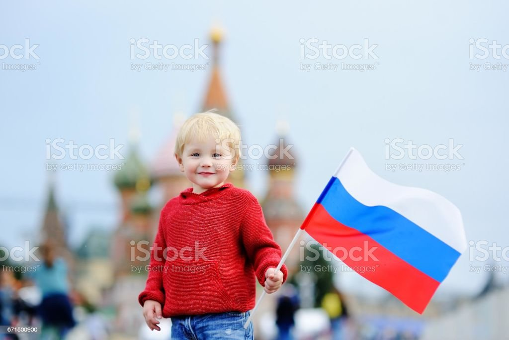 Cute toddler boy holding russian flag stock photo