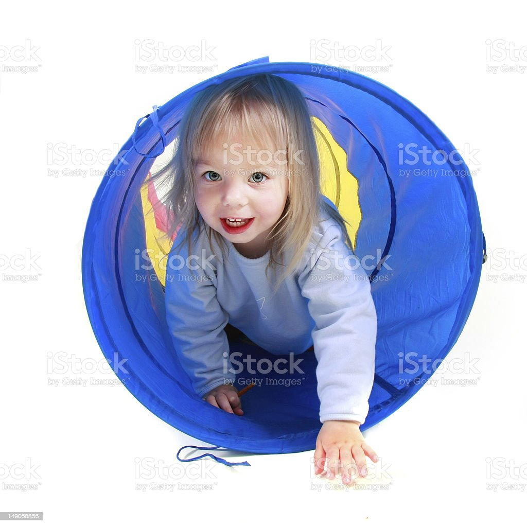 cute toddler girl playing in colorful tube over white royalty-free stock photo