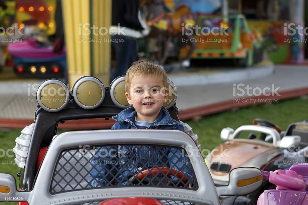 Cute toddler on a merry-go-round royalty-free stock photo