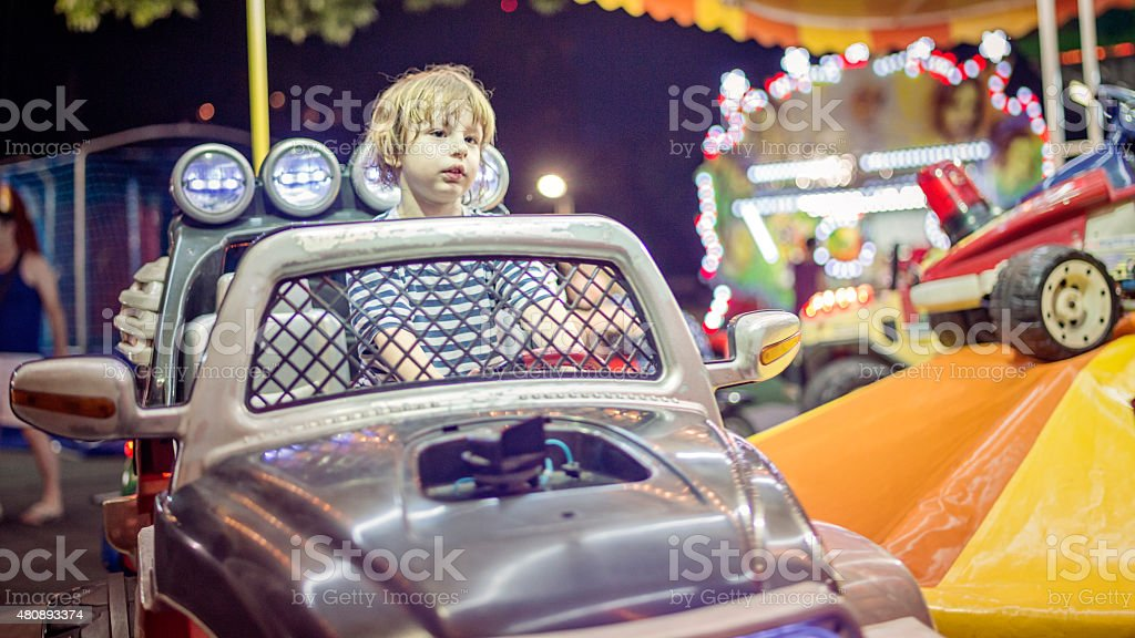 Cute toddler on a merry-go-round stock photo