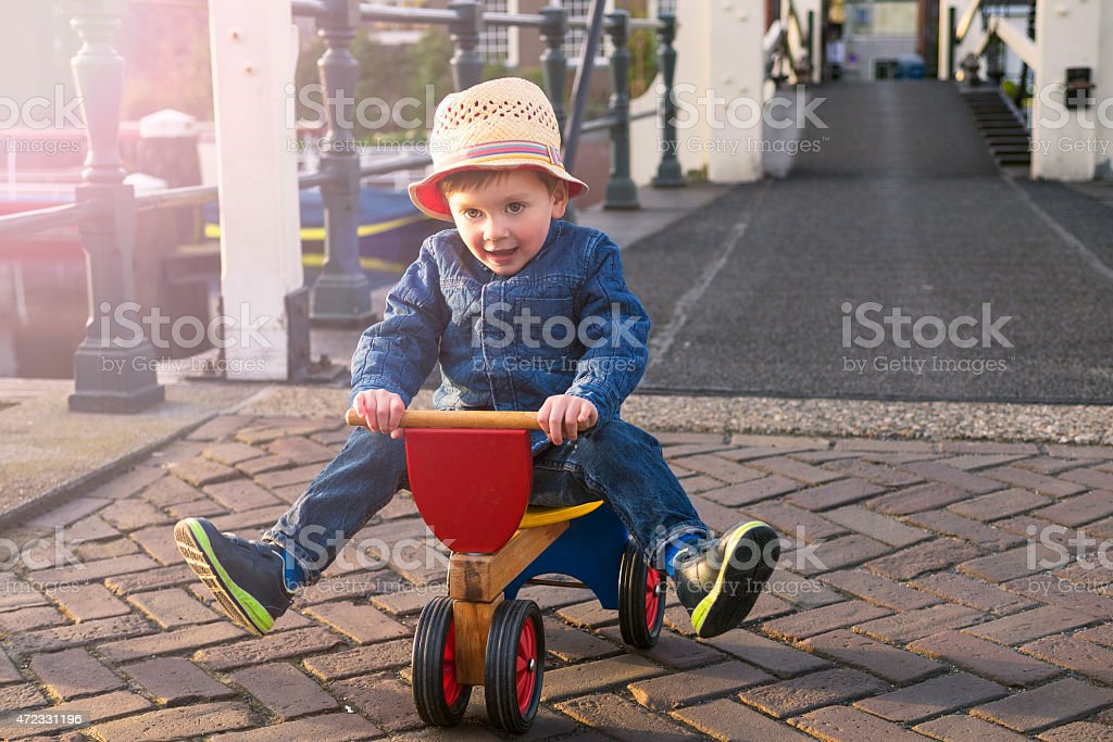 cute toddler on a tricycle stock photo