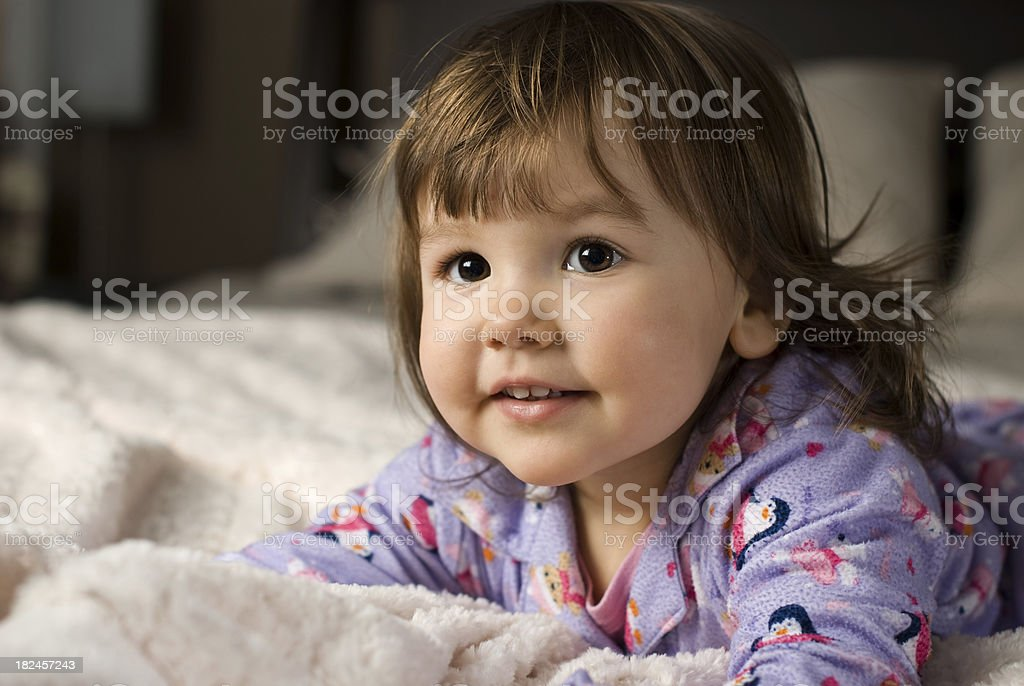 Cute toddler on bed royalty-free stock photo