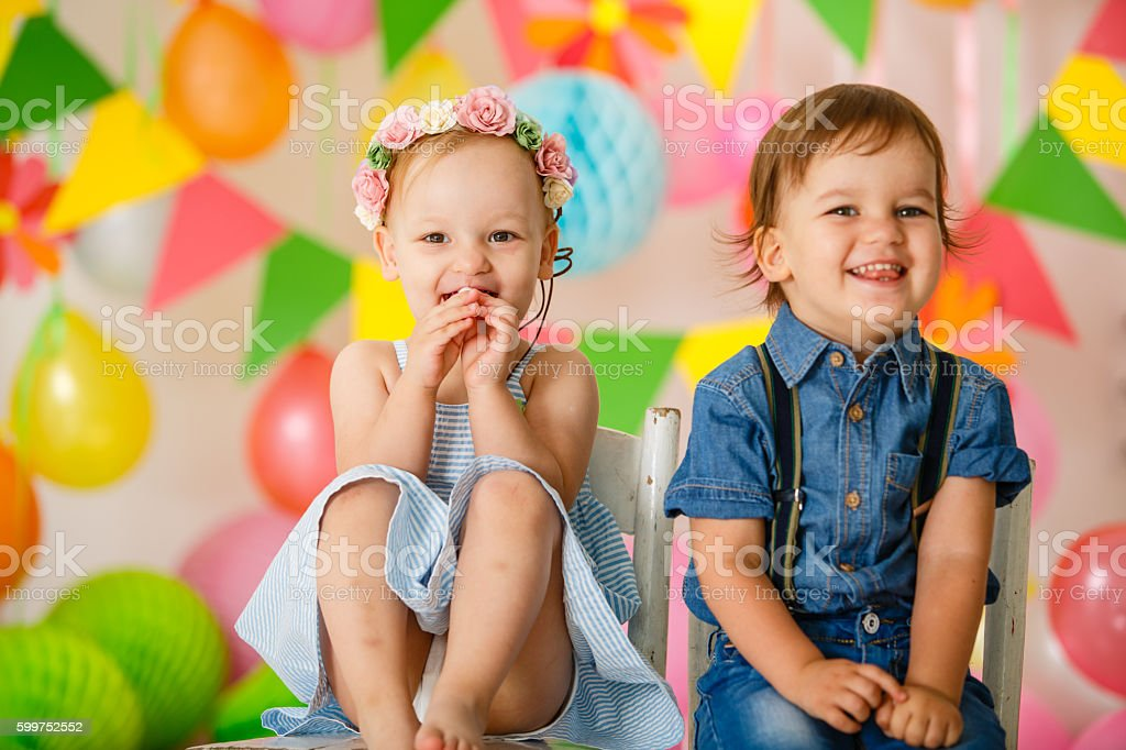 Cute toddler twins at birthday party stock photo