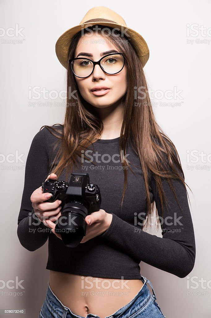 Cute tourist girl with photo camera on a white background stock photo