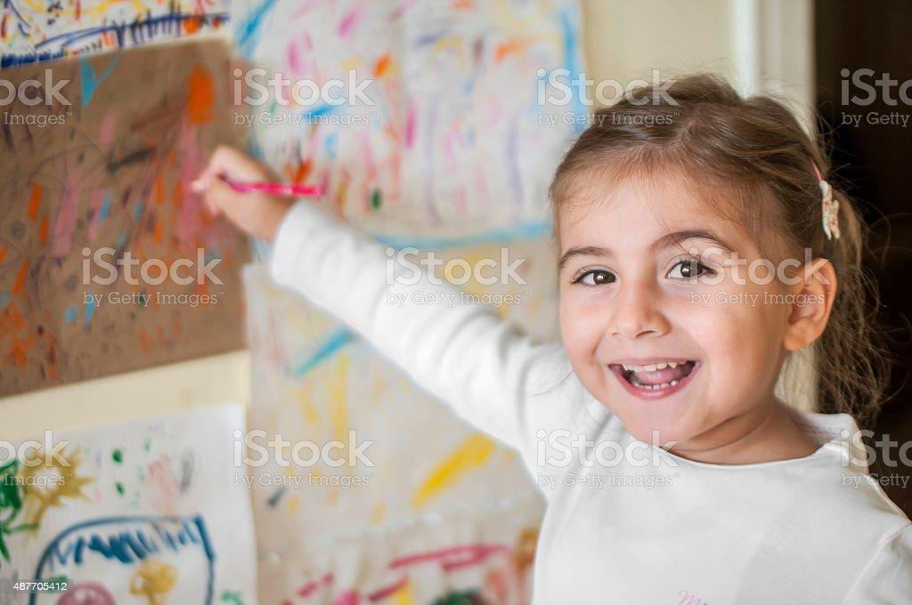 Cute Turkish girl drawing stock photo