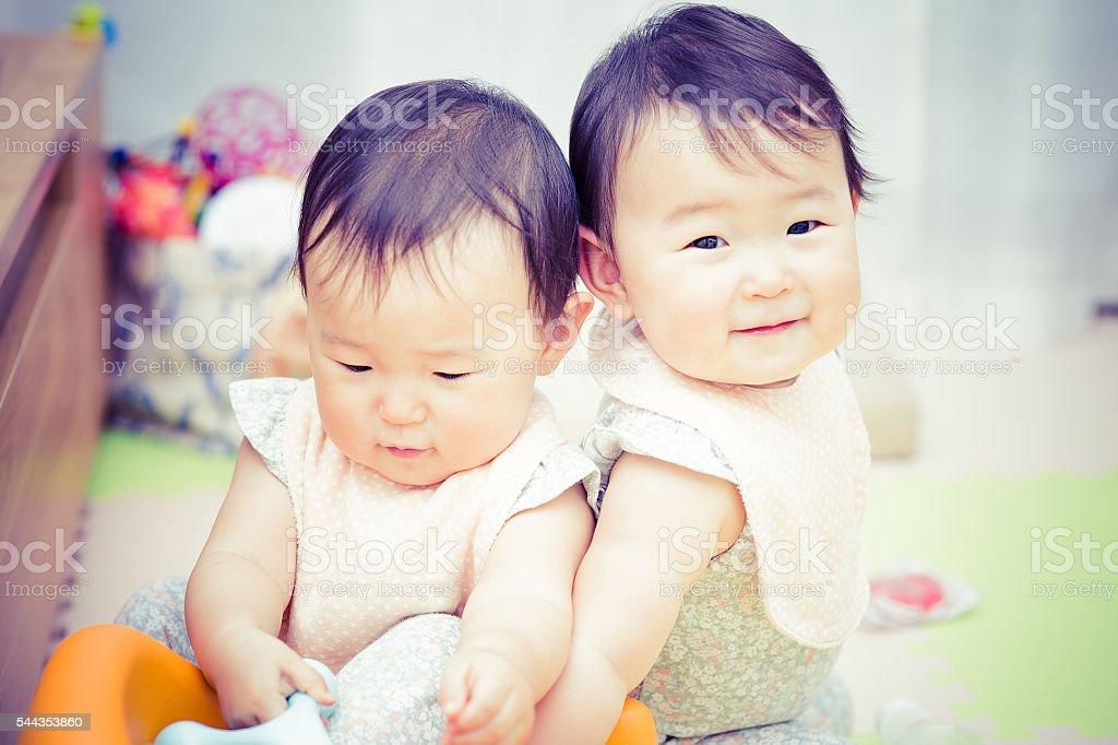 cute twins stock photo